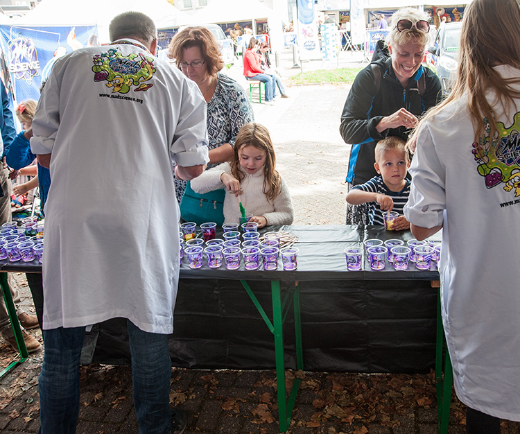 Kids at a booth playing with slime